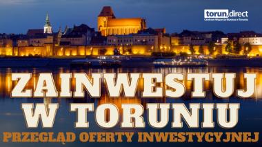 Na zdjęciu panorama miasta Torunia nocą, napis zainwestuj w Toruniu
